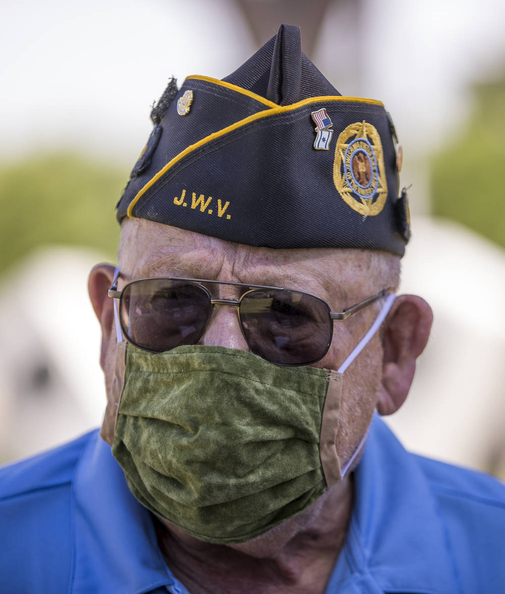 Retired Army Lt. Steve Seiden pauses while planting more American flags on veteran's graves in ...