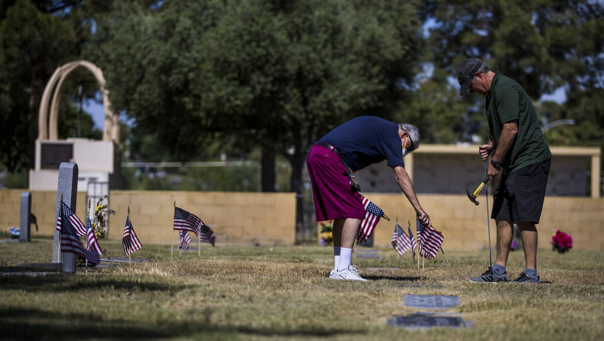 Mort Friedlander, left, and son Frank team up to plant more American flags on veteran's graves ...
