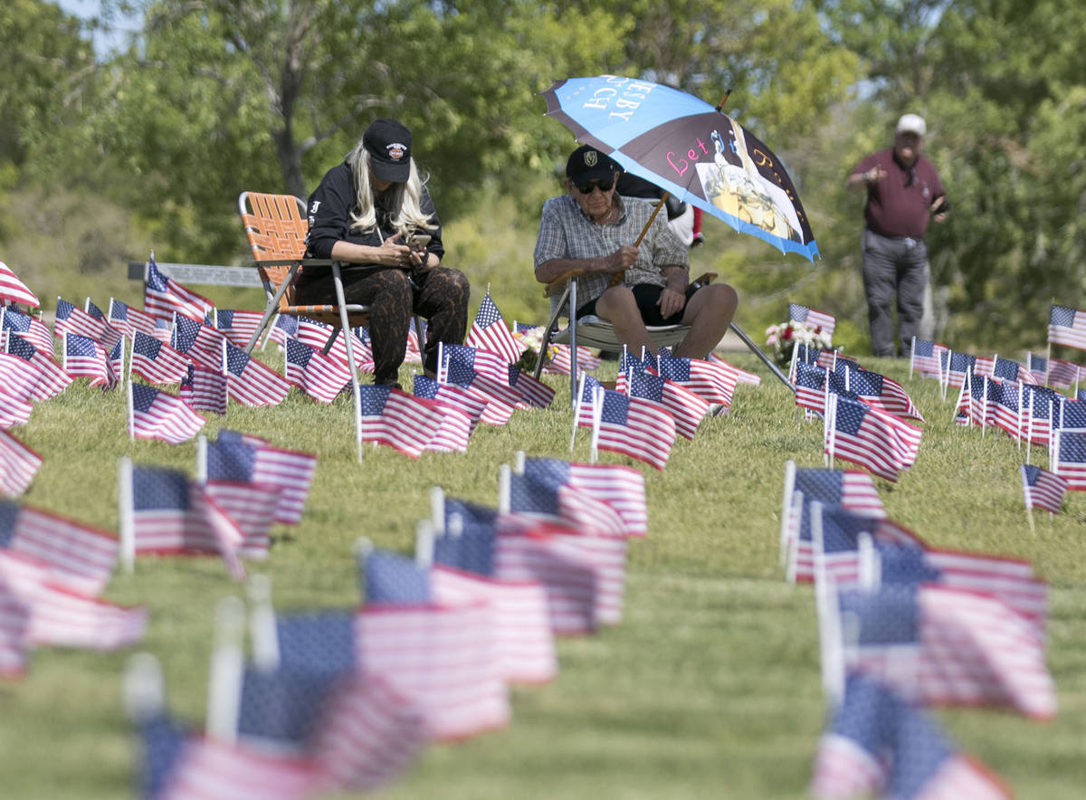 U.S. Army Pfc. Daniel Ventura, right, visits his wife Connie's grave site with his daughter, Lu ...