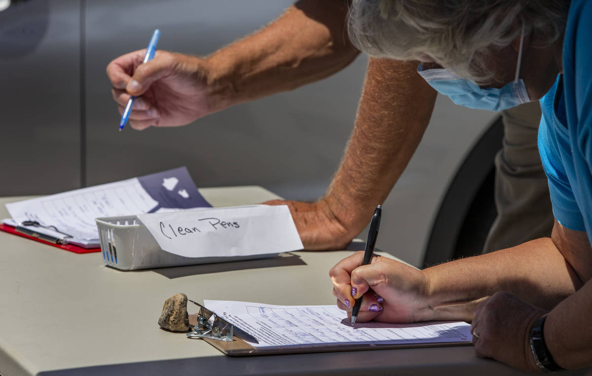 Residents sign as Henderson Coalition for Responsible Government volunteers seek signatures to ...