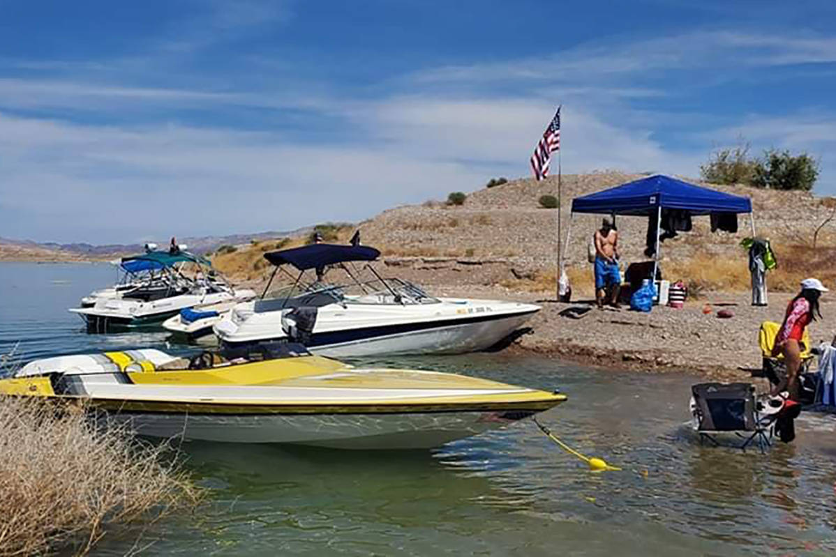 Some boaters get an early start on the Memorial Day Weekend on Thursday, May 21, 2020, at Lake ...