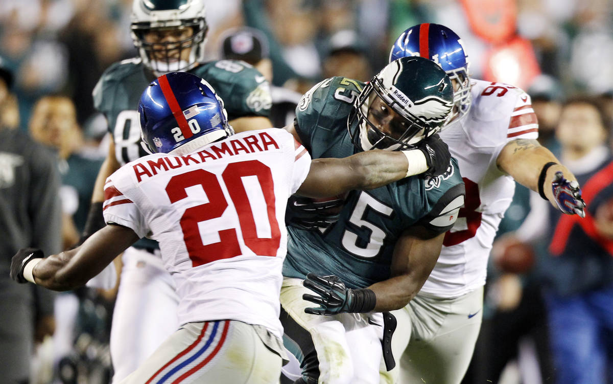 New York Giants corner back Prince Amukamara (20) tries to tackle Philadelphia Eagles running b ...