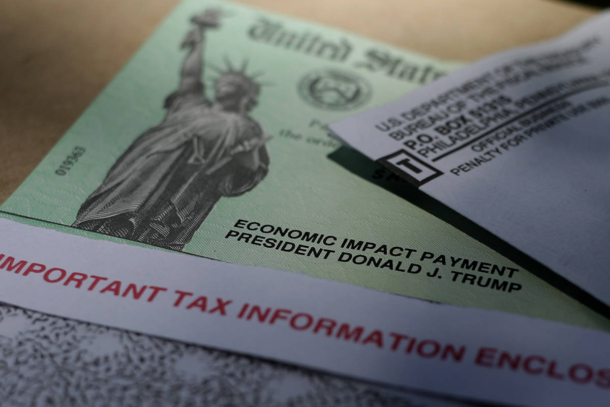 President Donald J. Trump's name is printed on a stimulus check issued by the IRS to help comba ...