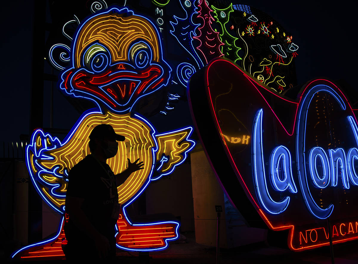 Interpreter Wyatt Currie leads a tour at The Neon Museum on Friday, May 22, 2020, in Las Vegas. ...