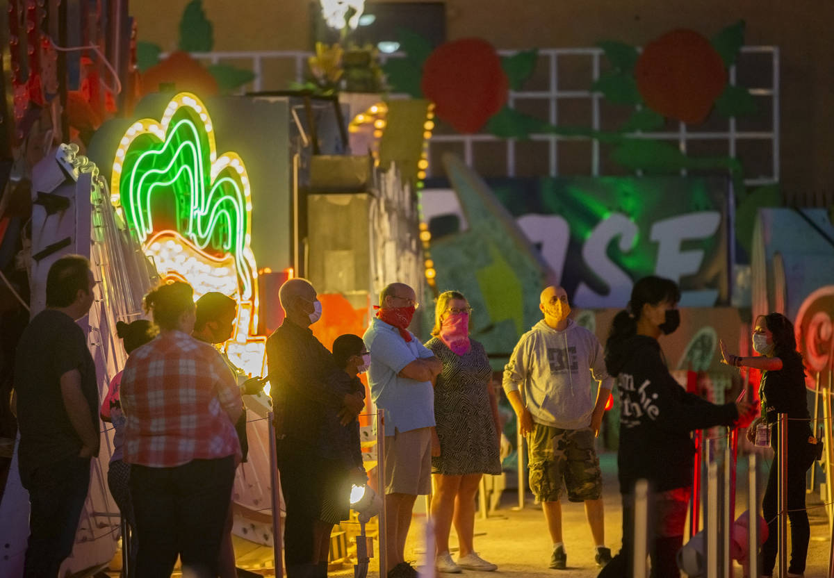 A group tours The Neon Museum on Friday, May 22, 2020, in Las Vegas. Friday was the first night ...