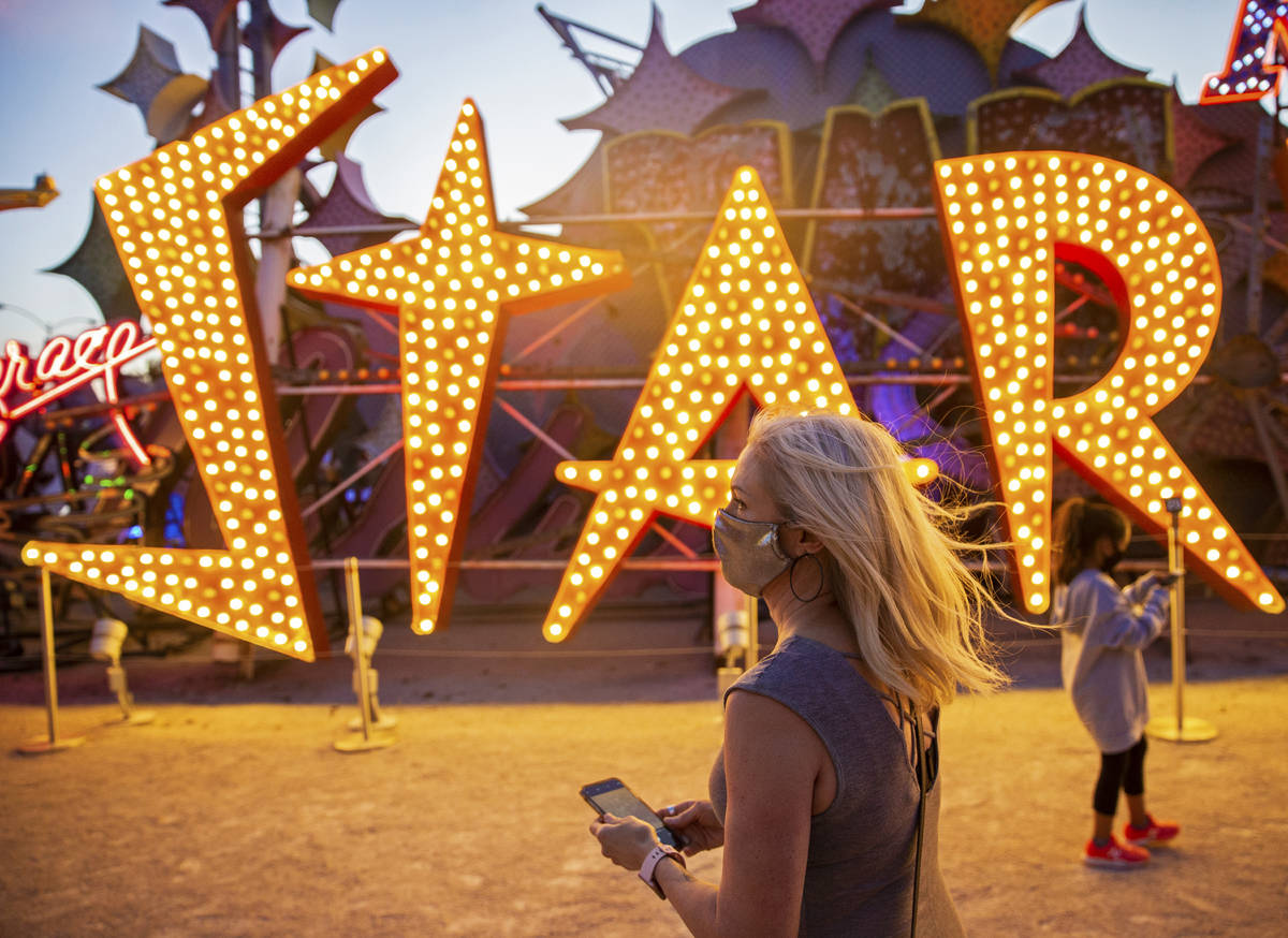 Heather Carpenter, left, takes a photo during a tour at The Neon Museum on Friday, May 22, 2020 ...