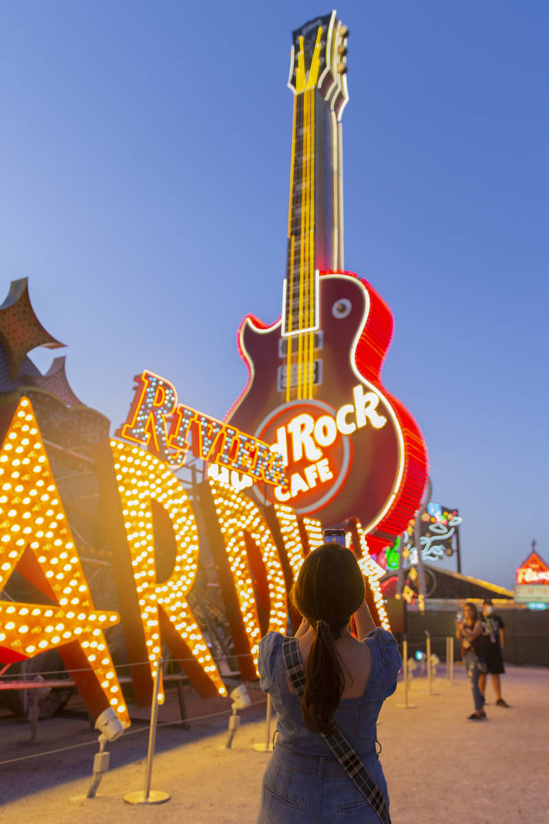 Kristine Bressel takes a photo during a tour at The Neon Museum on Friday, May 22, 2020, in Las ...