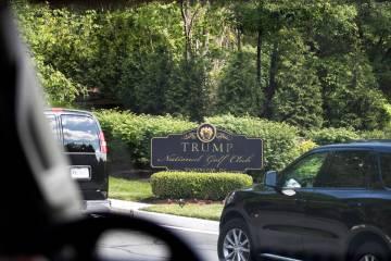 The motorcade for President Donald Trump arrives at Trump National Golf Club, Saturday, May 23, ...