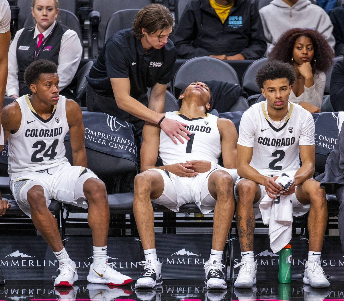 Colorado guard Tyler Bey (1, center) is tapped out on the bench during a rest versus Wyoming du ...