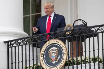 "President Donald Trump points during a ""Rolling to Remember Ceremony,"" to honor the n ..."