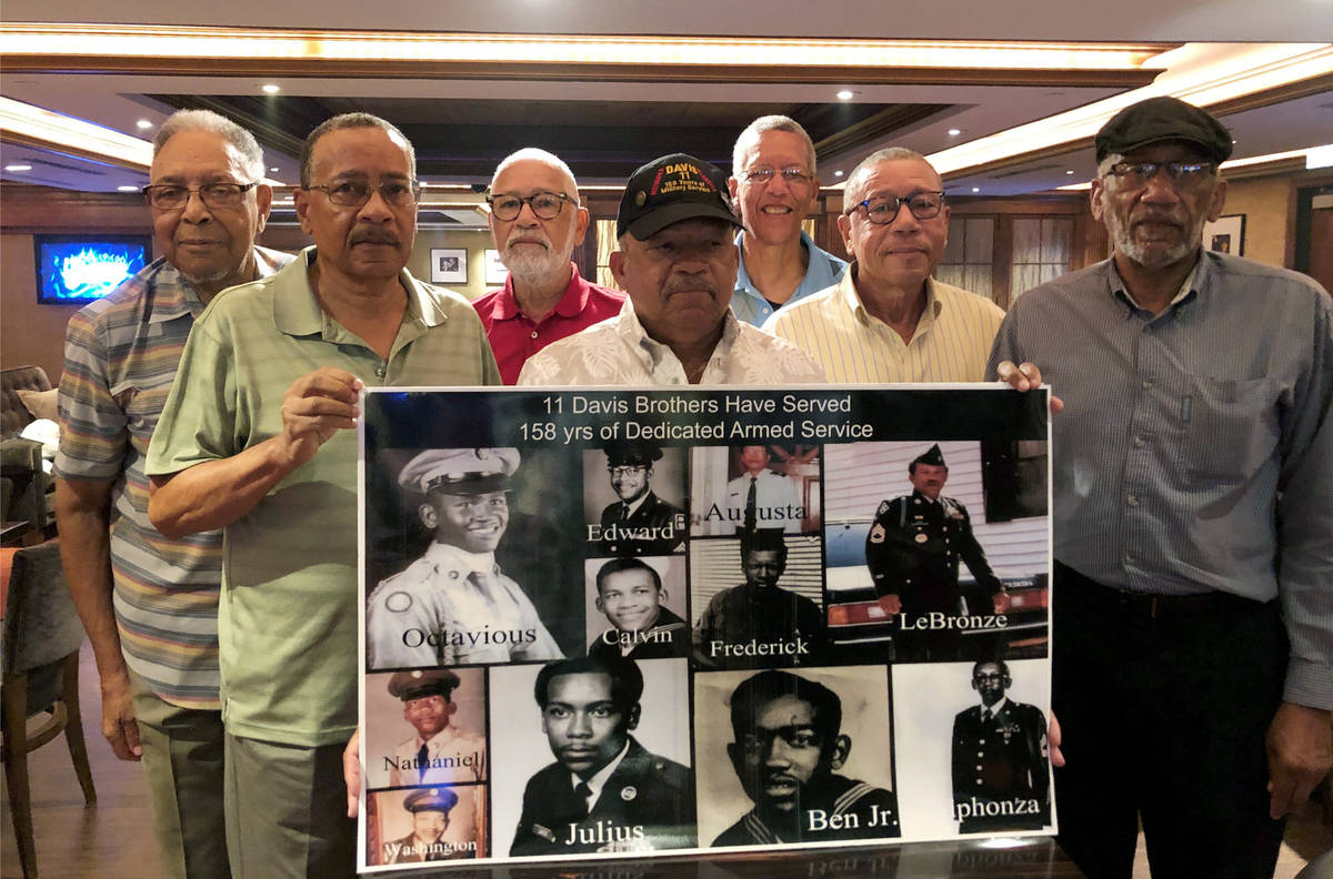 FILE - In this July 12, 2019 file photo, from the left; Eddie Davis and his brothers Julius, Oc ...