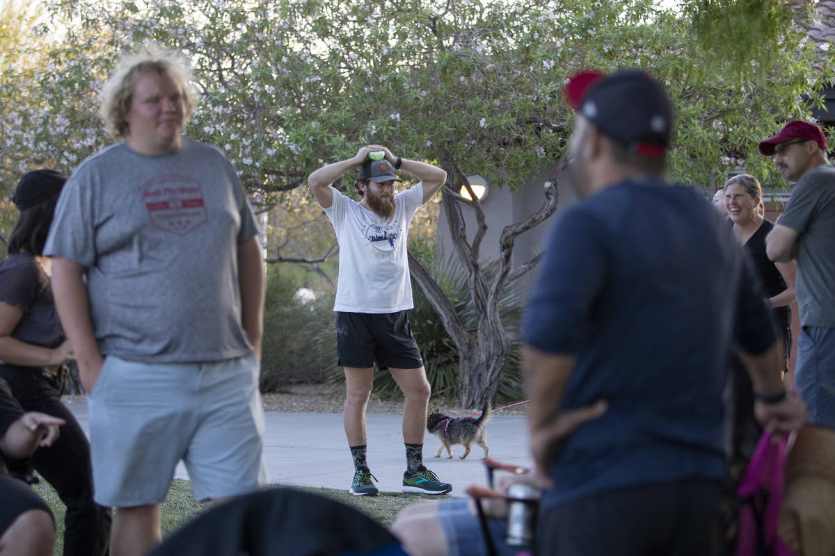 Peter Makredes takes a break from running with his friends and family at Exploration Peak Park ...