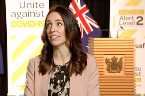 In this image made from video, New Zealand Prime Minister Jacinda Ardern looks up when an earth ...