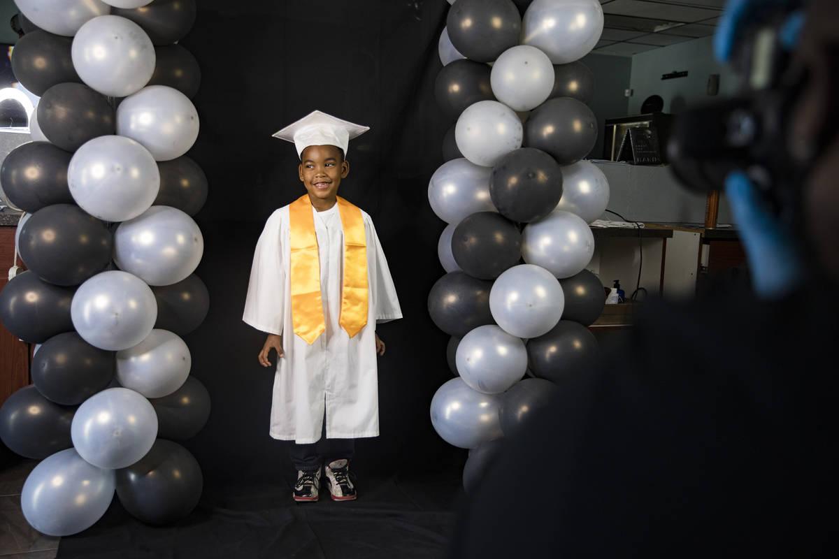 Dr. Dillard A. Scott takes a photo of Jourdyn Carson, 6, for his kindergarten graduation at Mr. ...