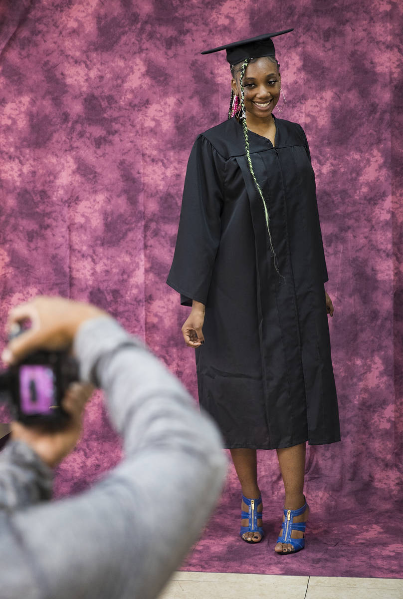 Herb Holder takes a photo of Destiny England, 17, for her high school graduation at 5 Star Barb ...