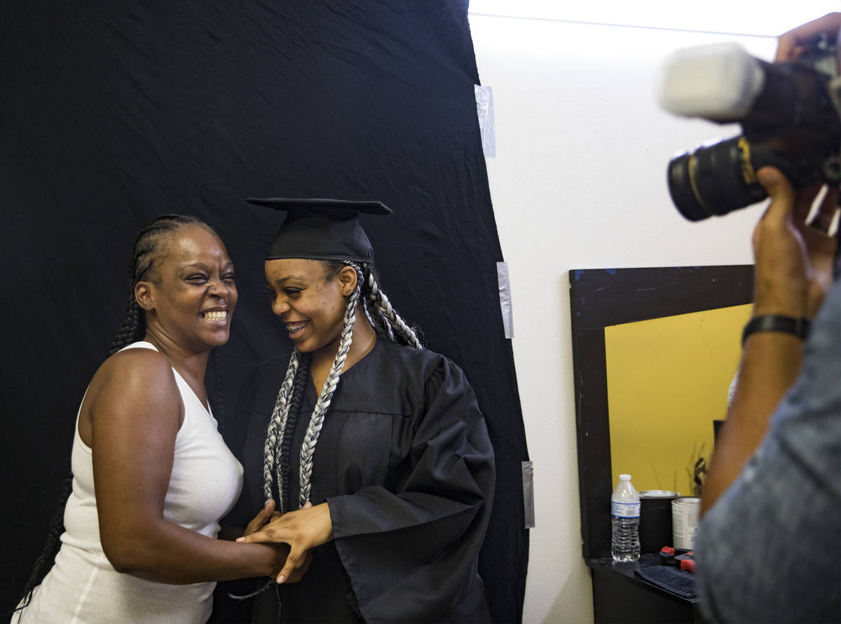 Kamika Adams laughs with her daughter Le 'Quitta Ragland, 18, as Julian Kemper takes a photo fo ...