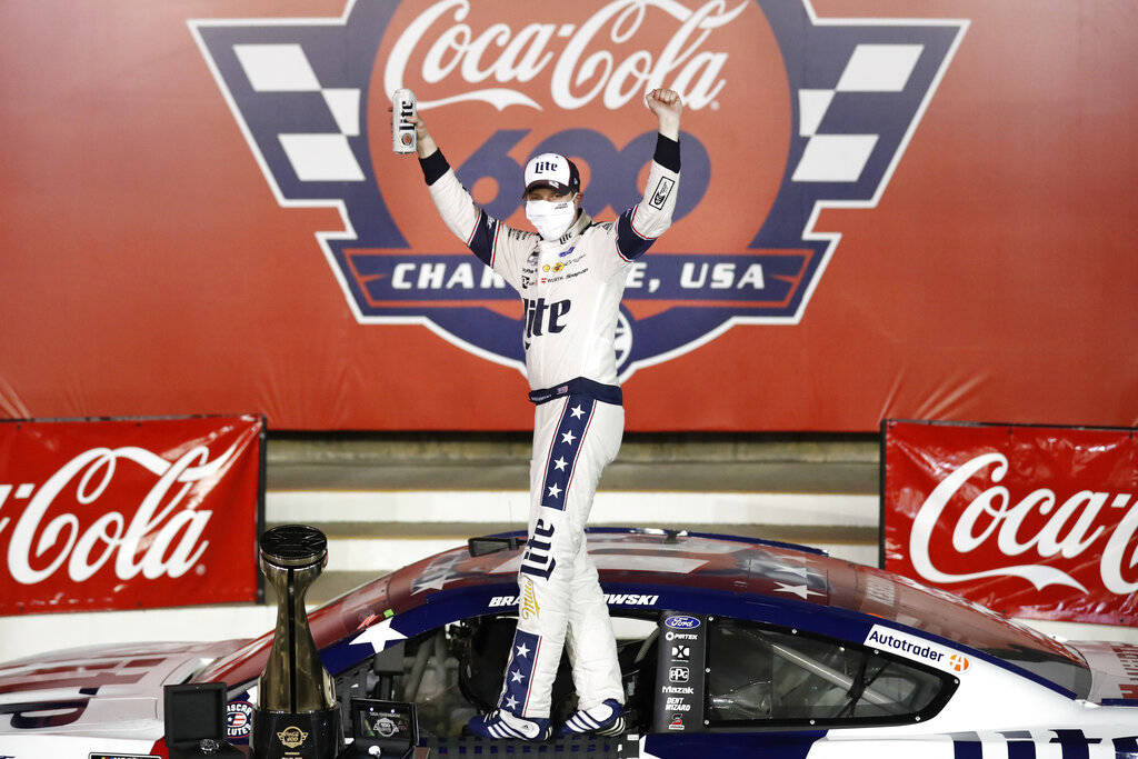 Brad Keselowski celebrates after winning the NASCAR Cup Series auto race at Charlotte Motor Spe ...