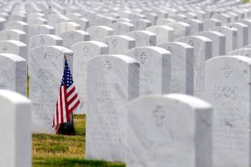 In a May 22, 2020, photo, a U.S. flag decorates a veteran's grave at Alabama National Cemetery ...