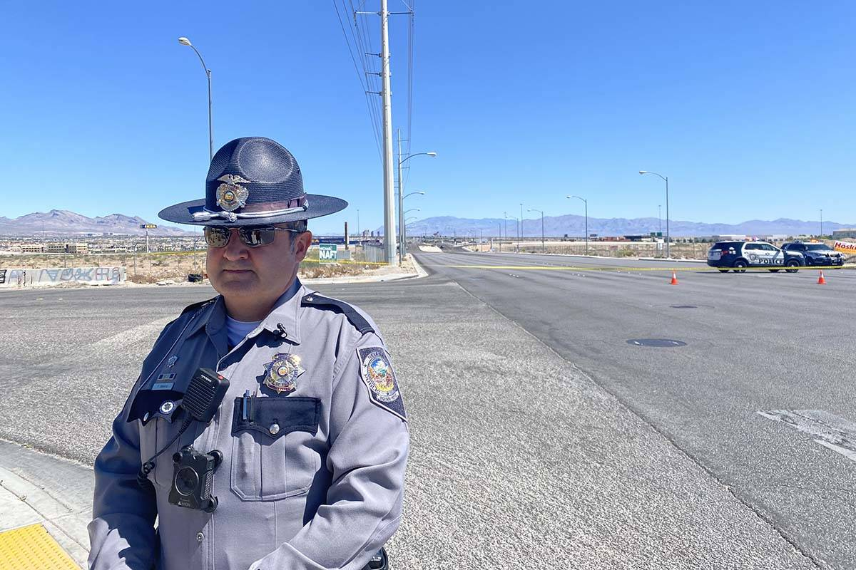 Nevada Highway Patrol Trooper Travis Smaka briefs the media after a motorcyclist was killed in ...