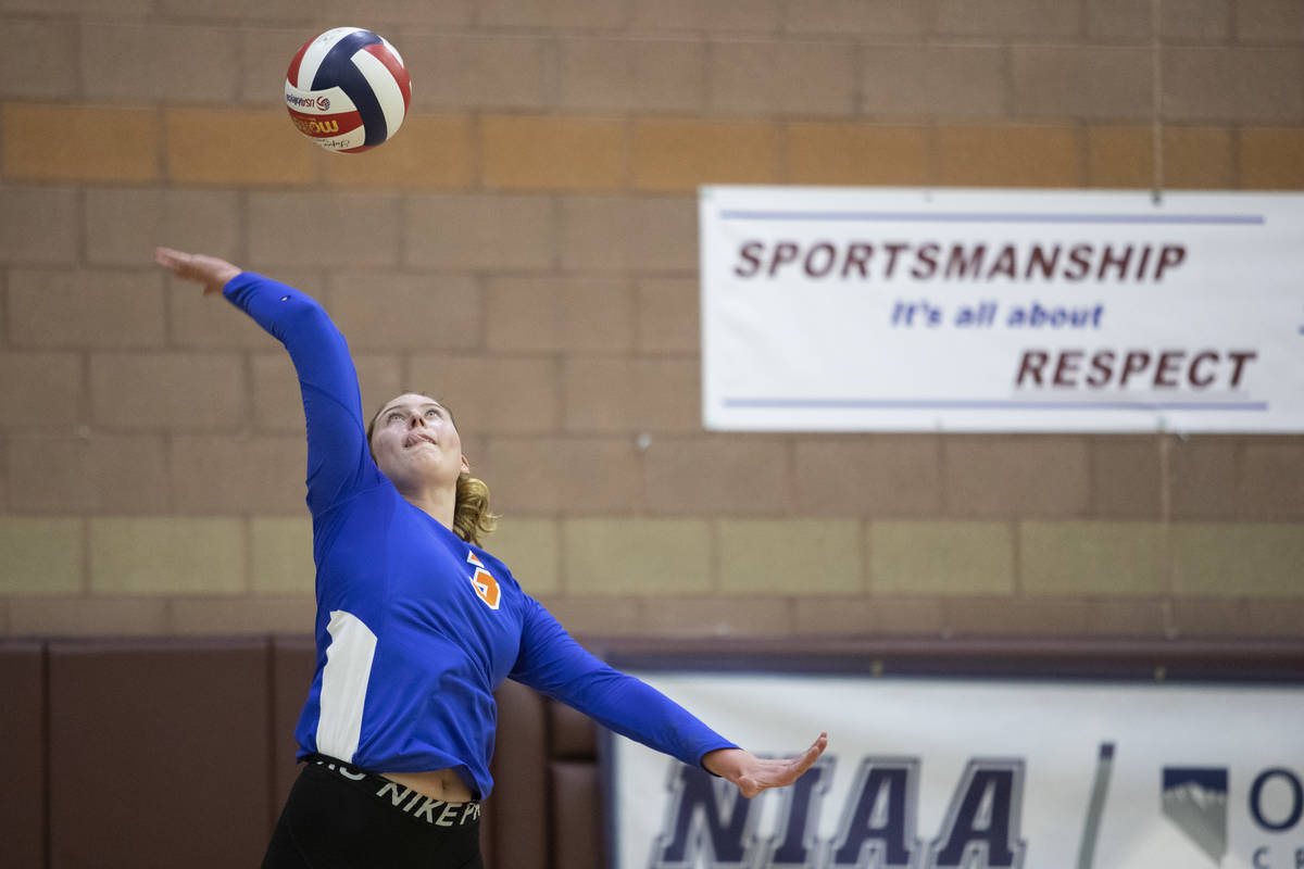 Bishop Gorman's Tommi Stockham (3) serves the ball during the Class 4A state volleyball champio ...