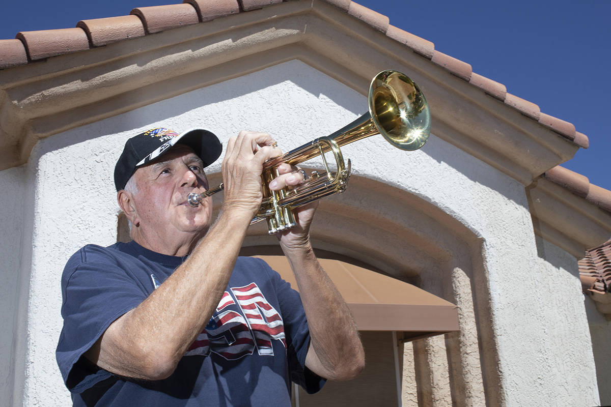 Bob Altomondo, who played trumpet in the Navy, poses for a photo before playing TAPS outside hi ...