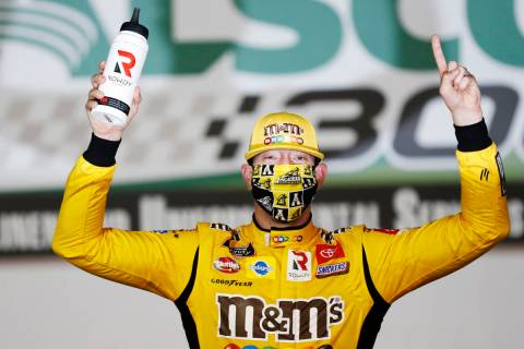 Kyle Busch (54) celebrates after winning the NASCAR Xfinity Series auto race at Charlotte Motor ...