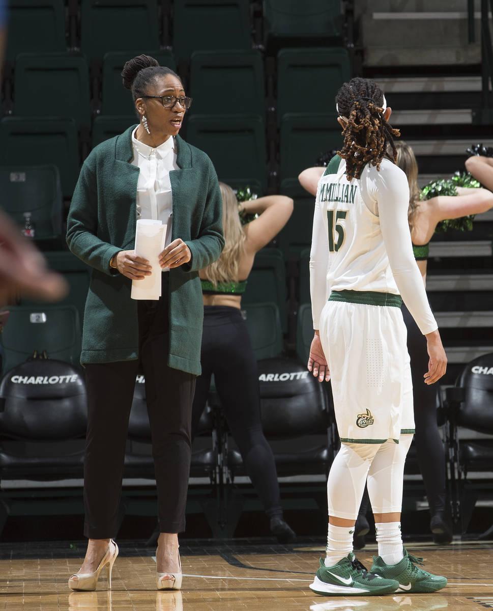 Charlotte women's basketball head coach Tanisha Wright talks with guard Jada McMillian. (Sam Ro ...