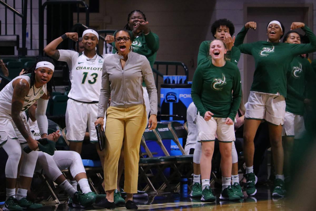 Charlotte women's basketball head coach Tanisha Wright cheers with her team. (Eric Besserman)