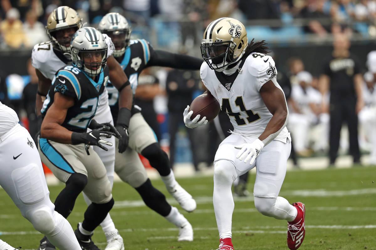 New Orleans Saints running back Alvin Kamara (41) runs against the Carolina Panthers during the ...
