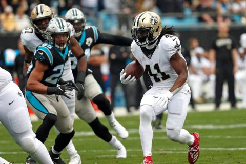 New Orleans Saints running back Alvin Kamara (41) runs against the Carolina Panthers during the ...