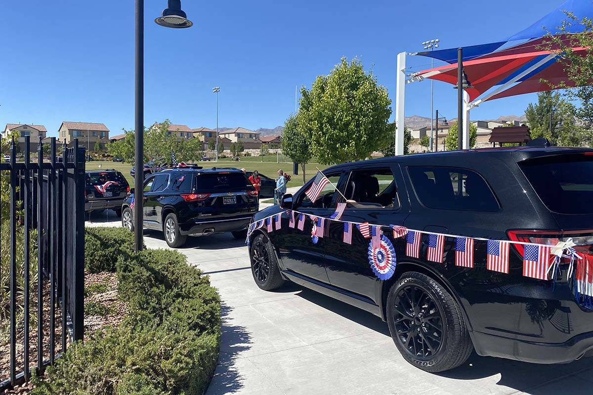 Cars line up to take part in Skye Canyon's inaugural Patriotic Car Parade in northwest L ...