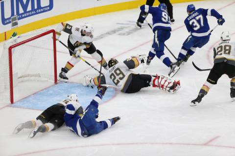 Vegas Golden Knights goaltender Marc-Andre Fleury (29) defends a shot against Tampa Bay Lightni ...