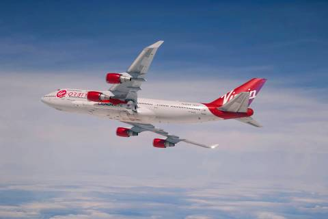 This Sunday, April 12, 2020 photo provided by Virgin Orbit shows a Boeing 747 with a rocket slu ...