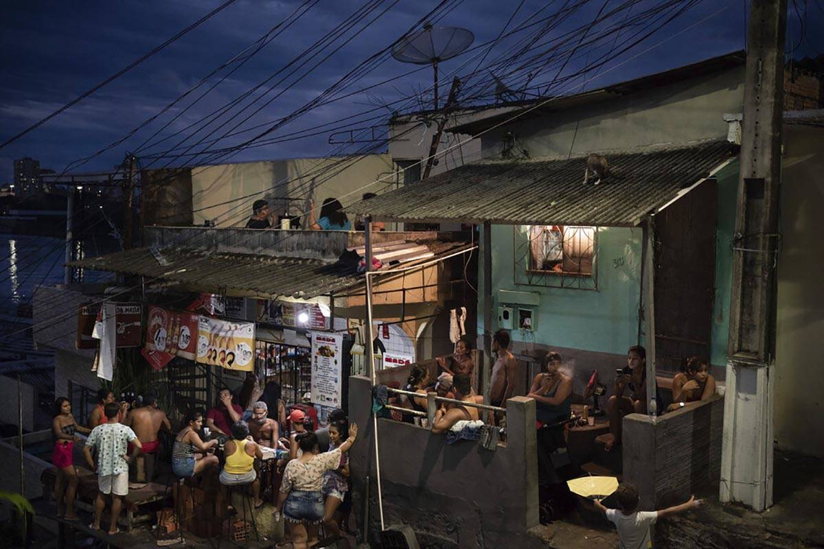 People gather outside a bar in Manaus, Brazil, Sunday, May 24, 2020, amid the new coronavirus p ...