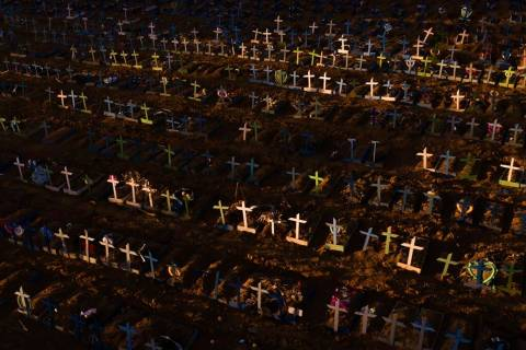 Crosses mark the graves of those who have passed away since early April, filling a new section ...