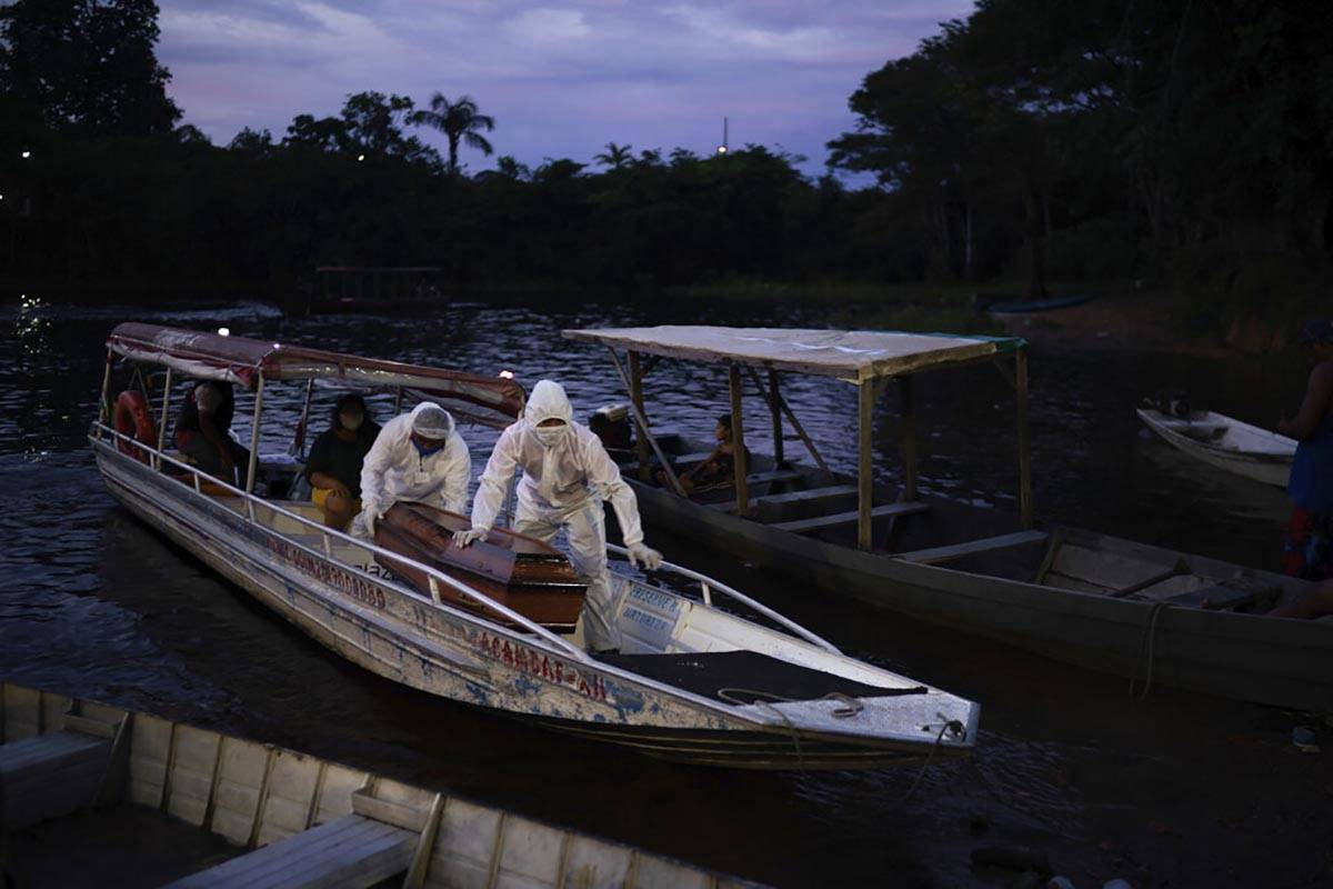 SOS Funeral workers transport by boat a coffin carrying the body of an 86-year-old woman who li ...