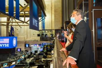 In this image provided by the New York Stock Exchange, New York State Gov. Andrew Cuomo looks o ...