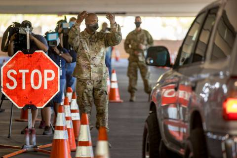 A Nevada National Guard soldier directs a drive-thru demonstration following the Clark County m ...