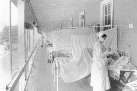 FILE - In this November 1918 photo made available by the Library of Congress, a nurse takes the ...