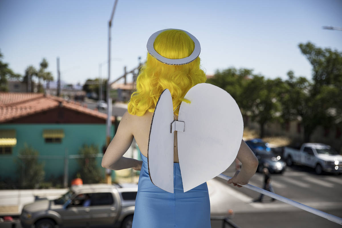 Victoria Hogan, dressed as the Blue Angel statue from the former Blue Angel Motel, stands on to ...