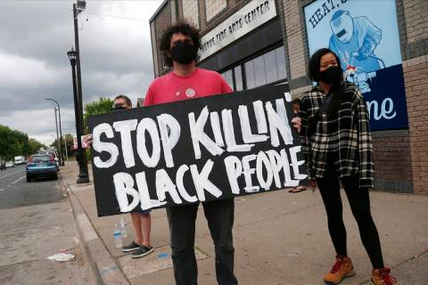 Protesters gather near the site of the death of a man, Tuesday, May 26, 2020, who died in polic ...