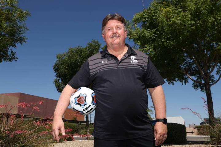 Bob Chinn, head coach of the Faith Lutheran girl's varsity team, poses for a photo at Faith Lut ...