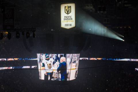 The West Coast Conference Champion and Pacific Division Champion banners are illuminated before ...
