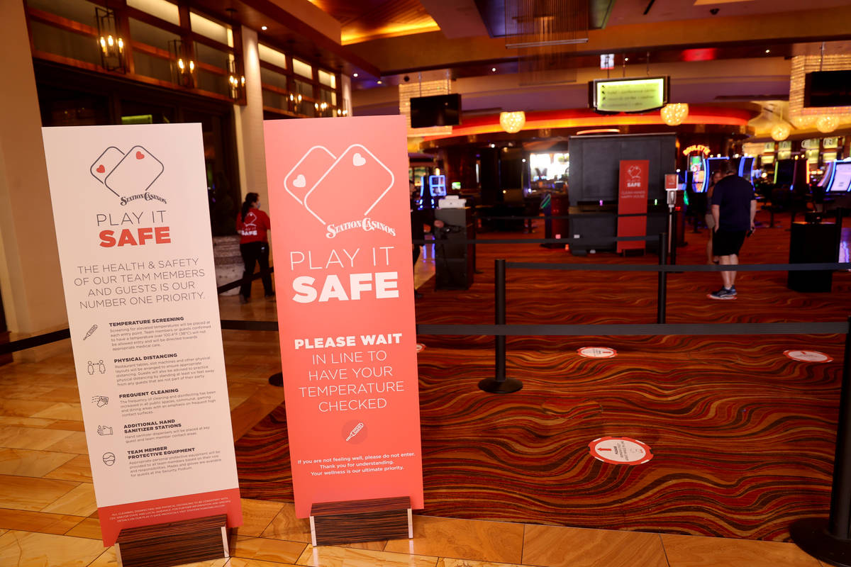 Customers line up for temperature screening at Red Rock Resort in Las Vegas Tuesday, May 26, 20 ...