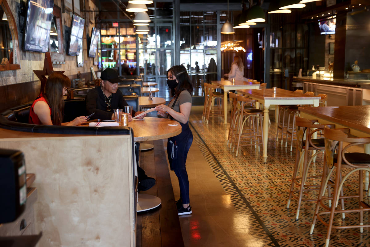 A server helps customers at Hearthstone Kitchen & Cellar at Red Rock Resort in Las Vegas Tu ...