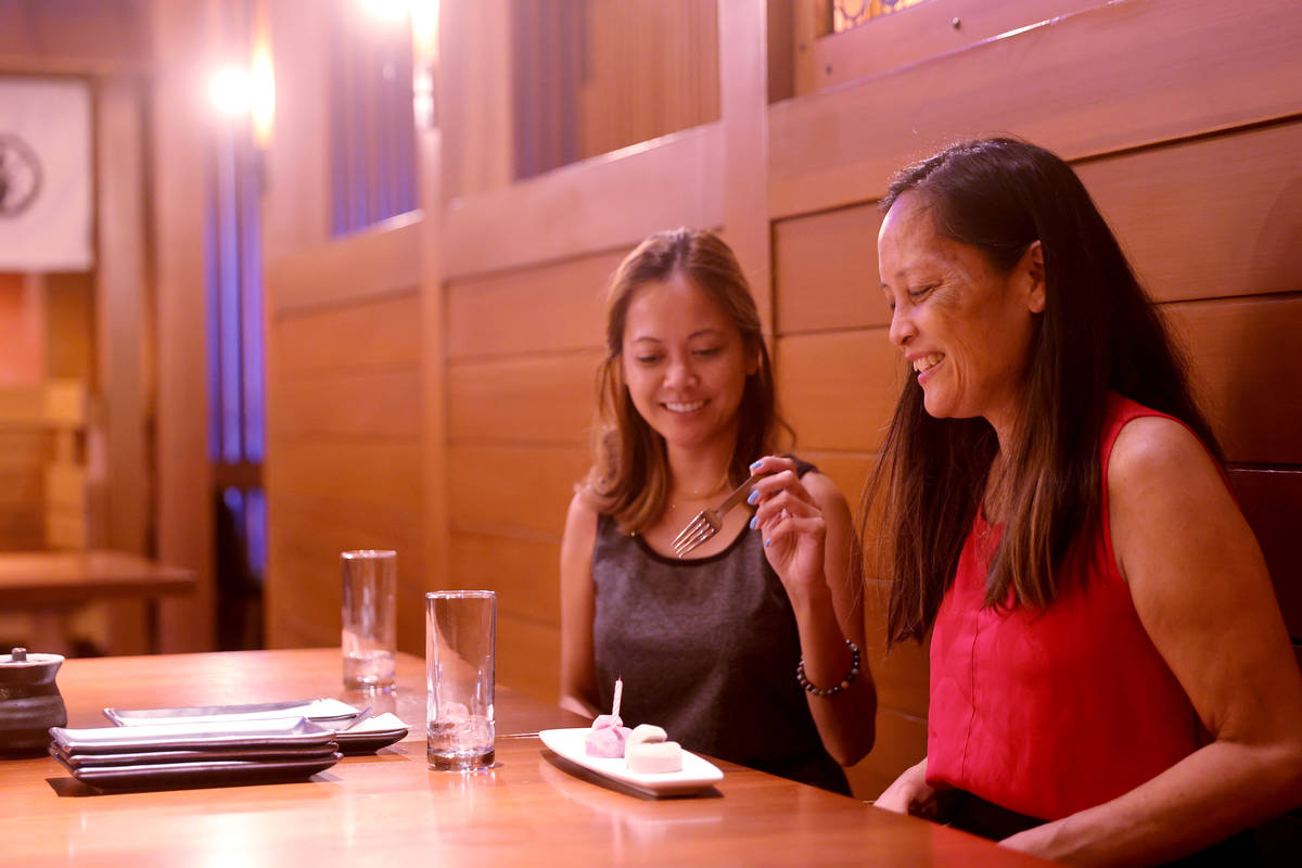 Sisters Chanel Banez, left, and Caron Banez of Las Vegas at Blue Ribbon Sushi Bar & Grill a ...