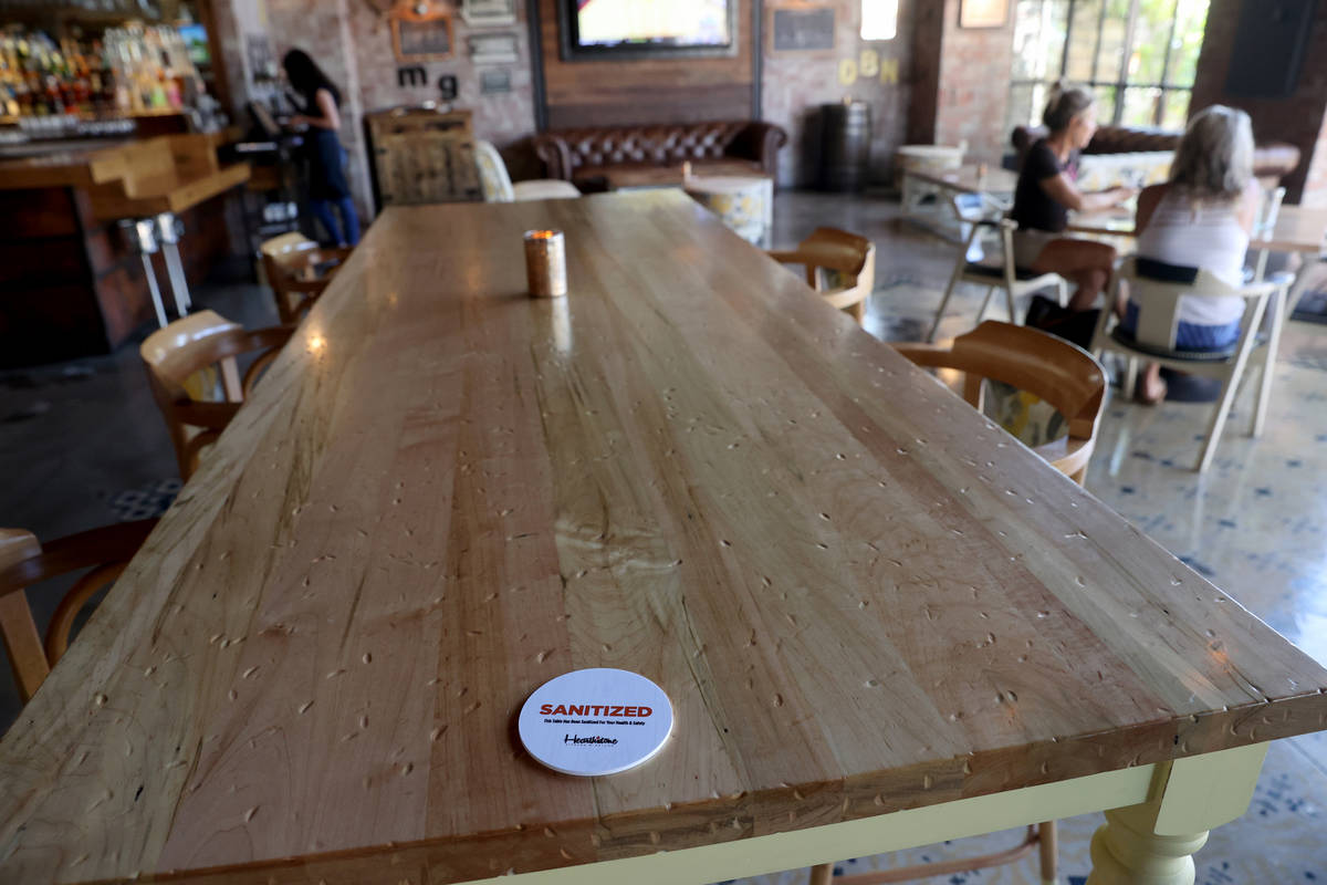A table is marked as sanitized Hearthstone Kitchen & Cellar at Red Rock Resort in Las Vegas ...