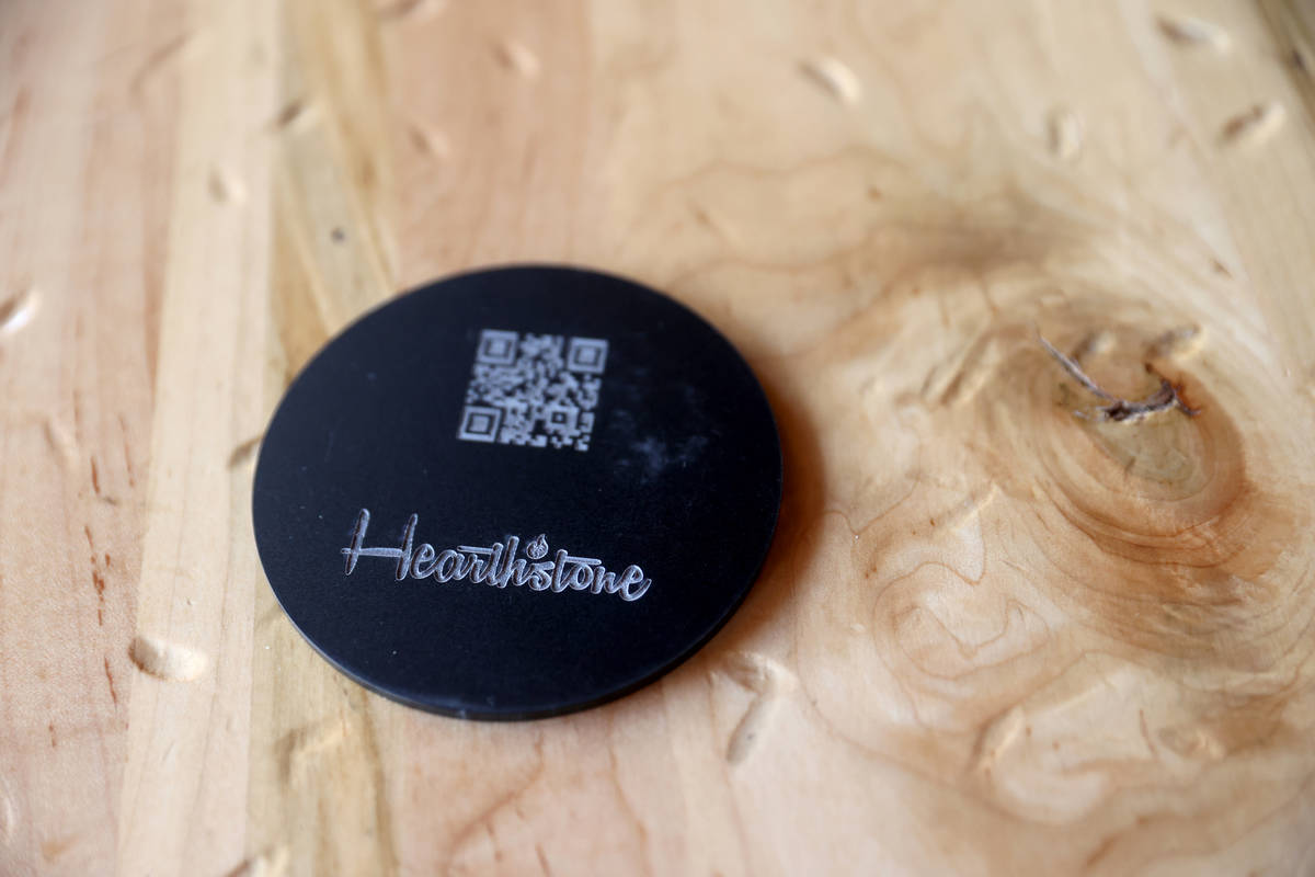 A coaster with a QR Code for the menu at Hearthstone Kitchen & Cellar at Red Rock Resort in ...