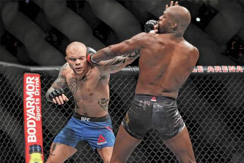 Anthony Smith, left, battles Jon Jones in the light heavyweight title bout during UFC 235 at T- ...