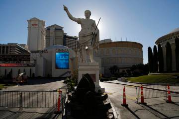Gates block an entrance to Caesars Palace hotel and casino along the Las Vegas Strip devoid of ...